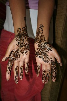 Mehndi. Traditionally for a girls wedding she is adorned with henna on her hands and feet. Somewhere individually painted into the design is the husband and wife's initials. Neither knows the wherabouts so there's some fun to be had on the wedding night trying to locate the letters.