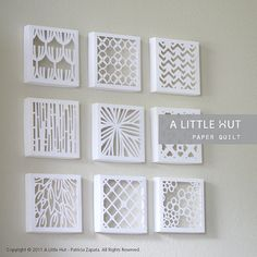 Cut paper boxed wall art.