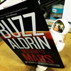 """Buzz Rover - Bookworm! He was spotted in the museum store office checking out Buzz Aldrin's book about Mars exploration! Did you know the book """"Mission to Mars: My Vision for Space Exploration"""" is where """"space statesman"""" Buzz Aldrin advocates for the continuing quest to push the boundaries of the universe as we know it? He is a pioneering astronaut who set foot on the moon during mankind's first lunar landing. In this book, Aldrin documents his vision of a path to land humans on Mars by…"""