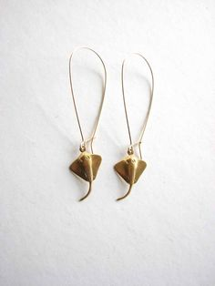 Petite, brass stingray charms hang from long kidney wires. The total length for these sting ray earrings is just over 2.5. The rays themselves