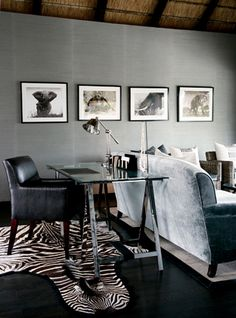 Londolozi Lodge -- Sabi Sands S. Afr. -- love the black and white wildlife photos against the gray walls -- very striking.
