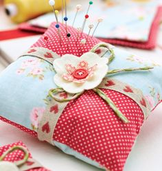 Keep your stitching tools nice and tidy with this set, featuring a pincushion, scissor case and needle wrap