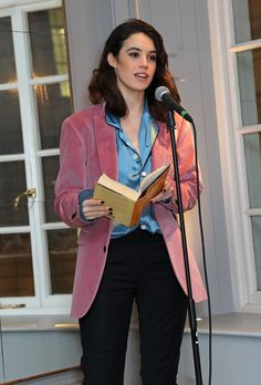 English actress and model Gala Gordon reading poetry at Thomas's yesterday evening. The event celebrated poetry themed around Great Britain. A rose pink jacket in soft velvet with a silk pyjama-style shirt from the Burberry runway collection.
