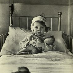 LONDON.. Three-year-old Eileen Dunne poses on her hospital bed for famed English photographer Cecil Beaton. Eileen was a victim of the German bombing of London 1940.