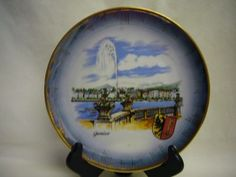 "7 3/4"" in diameter Geneve tourist plate, collectors item.  Beautiful bold colors compliment the gold rim.  Comes with hangar already on back.  Bavaria, Germany.  No chips, no cracks no scratches."