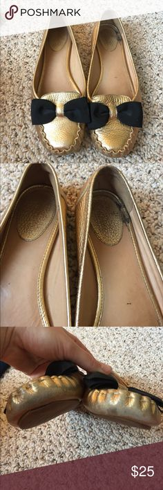Kate Spade Gold Moccasins These are metallic gold Moccasins with black ribbon bows. They have been worn and reflect wear. The inside soles have some staining, the toe box shows wear, and the soles of the shoes have wear. Please review all pictures. The price has been adjust accordingly. Size 8. They are super comfortable but run on the larger size. I am a size 7.5-8 and these shoes are a little loose on me. kate spade Shoes Moccasins