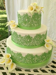 Lovely fresh green and cream wedding cake with lillies