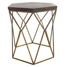Contemporary and artistic, the Threshold™ Metal Hexagon Table with Wood Top brings a decadent air to your space. This sculptural piece of home furniture looks fabulous next to a sofa or bed but can also be placed in an unexpected area and topped with a plant or decorative item for extra creative polish. Featuring an intersecting geometric diamond base in distressed gold and a unique hexagonal plank surface with a weathered natural wood finish.