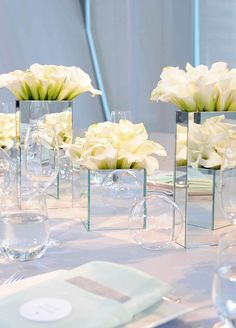 6. The architectural shape and variety of colors make calla lilies well suited for anything from a modern ballroom reception to an intimate ceremony on the beach. Colin Cowie Celebrations. #centerpiece #summerflowers #whiteflowers