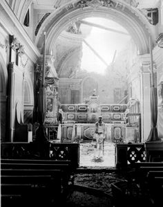 An American soldier standing at the altar of a bombed out Catholic church,WWII. Acerno, Italy - September 23, 1943