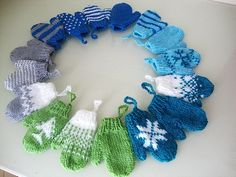 Mini Mittens- find some kids' mittens at the dollar store and i actually like this idea for a winter wreath.