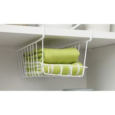 Features an innovative design that latches on to the shelf above, providing extra space to organize and store small items. A low hanging front lip allows for easy access to items in the basket, while still keeping them securely in place. Their customers have found multiple uses for this product including under a fridge shelf for small canned foods, under the bathroom self for dental products, or even by the door to place mail or paper into so it doesn't build up on the kitchen table.