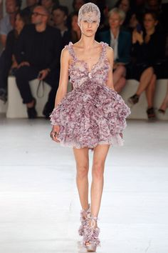 Could lose the head piece, but wow. McQueen Spring 2012 ready-to-wear.