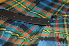 Close-up of a MacLellan Heavyweight 16 oz. kilt with premier bridle leather strap.