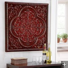 Metal Art Work  $99.00  Available in Red, Ivory, Blue, or Purple.  ~ Again, break up white walls with a pop of red.  This idea works perfectly and makes a statement. ~