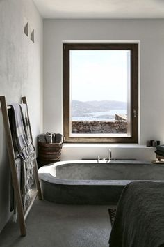This stunning Mediterranean house is located on the Greek island of Syros. Designed by (an architecture and interior design studio based in Athens, Greece) this summer house was adapted to the steep, dramatic topography and is position Home Interior, Bathroom Interior, Interior Architecture, Industrial Bathroom, Rustic Bathrooms, Bathroom Trends, Bathroom Inspo, Interior Decorating, Stone Bathtub