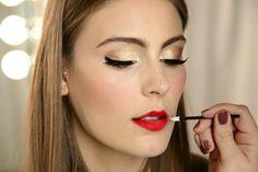 Love the gold eye make up and red lips. #JoytotheGirls