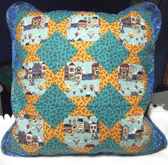 Houses and hot air balloons! Drift away with this cozy patchwork cushion. 20 x 20 inches - 100% cotton - wooden buttons - piping.