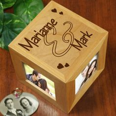 """Personalized Couples Valentine's Photo Cube. Give your favorite couple a truly beautiful Personalized Couples Photo Cube. Our Engraved Photo Cube is a wonderful gift for the Wedding Couple or newly engaged couple. Celebrate the love you have for one another with a beautifully engraved Photo Cube displaying your favorite 4 photographs. Our beautiful natural wood 4.5"""" personalized photo cube features 4 separate photo openings measuring 2.5"""" x 2.5"""". Includes FREE Personalization!"""