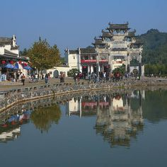 In the ancient villages of Xidi and Hongcun, you can see Mt. Huangshan (Yellow Mountain), the well-preserved ancient houses, memorial archways, shrines, bridges and streets.