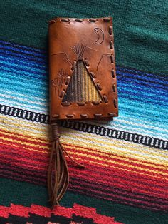 The+desert+scene+wallet+with+a+serape+teepee+measures+7+inches+by+4.5+inches+on+each+side,+it+has+two+alligator+hide+pockets+and+one+credit+card+holder+that+holds+multiple+cards!!