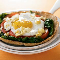 Pizza for breakfast? Why not? It's especially tasty when topped with a sunny-side-up egg and veggies. Quarter or halve the recipe for just one or two pizzas and try shredded part-skim mozzarella instead of feta, if you prefer.