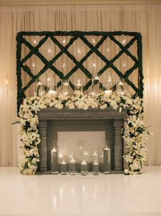 White Floral Garland on Mantel Ceremony Decor