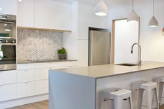Sleek concrete caesarstone a possibility for new island bench. We have these pendants over dining table.