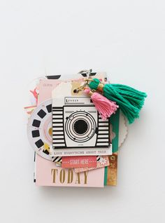 Paint chip mini album using open book collection by Maggie Holmes