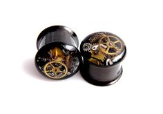 http://www.etsy.com/listing/159053225/black-steampunk-vintage-watch-parts-ear