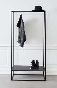 Geometric coat stands and book shelves feature in Kristina Dam's Sculptural…