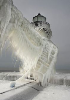 Ice-covered lighthouses at the St. Joseph North Pier on the coast of Lake Michigan