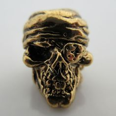 One-Eyed Jack Skull Bead in 18K Antique Gold Finish by Schmuckatelli Co.