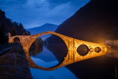 Ponte della Maddalena. the bridge that Matilda of Tuscany created just outside Lucca. It is breathtakingly beautiful how the stone semi-circles reflect perfectly in the water to create a complete circle. Named for Mary Magdalene and there was once a statue and chapel dedicated to her at the foot of the bridge.
