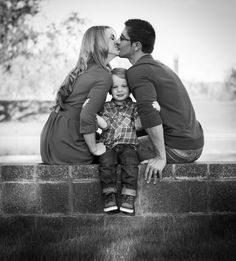 Cute Family Photo of 3. Add older kids sitting on each side for family of 5 or standing against the wall.