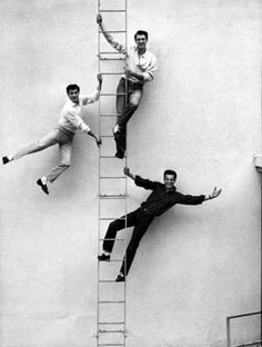 Tony Curtis, Rock Hudson & Robert Wagner pose on a fire escape at Universal Studios in Hollywood (1958)