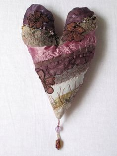 a textile art heart by CAROLYNSAXBYTEXTILES