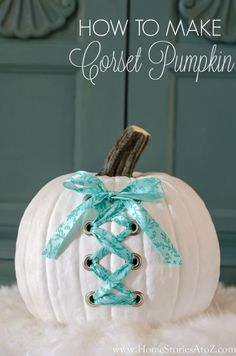 How to make a DIY corset pumpkin. Love that you can change the ribbon to completely change the look.