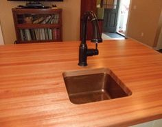 """The counters are made from """"Lyptus"""" they are not sealed but oiled as needed. I have seen them years after install and they still look terrific. This is a favorite wood for counters!"""