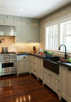 Farm house kitchen: I like the floors and the sink the most.