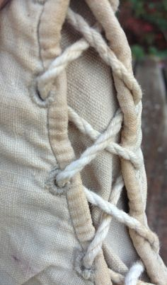 c1810 beige canvas boots. Detail of the front-lacing. Not sure if the laces are original, they may well be. I understand that they may not be correctly laced; the lace being treated as two threads, not one (see image of Sarah Siddon's boots). But then the Ackermann print shows cross-lacing.
