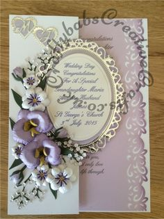 Wedding card made using a variety of dies including Spellbinders floral ovals, nesting plain ovals, plain and scalloped hearts and orchid dies Cheery Lynn Baby's breath dies, memory box flower, leaf and tulip dies and Britannia alphabet dies.