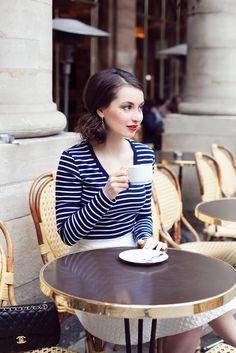 Parisian style. No fake tan , no fake eyelashes, no highlights. Simple yet chic outfit. Bold beautiful lip.