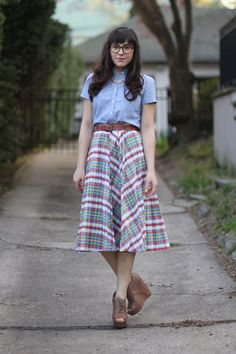 I can't believe I love this, but I do. This skirt is exactly what my mom wore to work in the 80s and what she would have loved to put me in. But the juxtaposition of the conservative slightly nerdy plaid and tea length against the funky shoes just WORKS. Wonder if it could work for a plus-size gal like myself.
