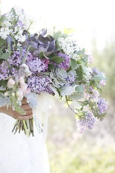 Bridal bouquet of lavender and white lilacs, dusty miller, succulents, snapdragons