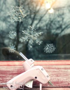 Glue gun Window Snowflakes- 22 Creative, Fun and Easy DIY Christmas Decor Projects