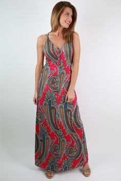 This paisley maxi dress is one of our most vibrant maxis yet! We love the strappy back and buttons down the front that make this more unique!