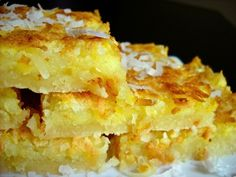 lemon coconut bars - Budget Bytes lemon and coconut-soooo good. Köstliche Desserts, Delicious Desserts, Dessert Recipes, Yummy Food, Tasty Snacks, Lemon Desserts, Lemon Recipes, Sweet Recipes, Lemon Coconut Bars