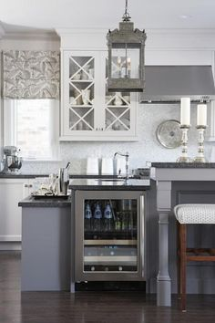 "Island Idea; step-down bar with wine fridge.  seating and main island at standard bar-height 42"" AFF love the valance"