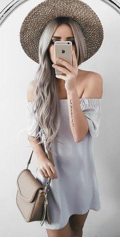 bohemian girl wearing cute off the shoulder dress